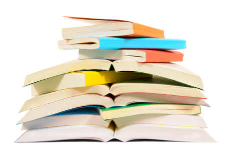 books: Closeup untidy small pile of paperback books isolated on white background