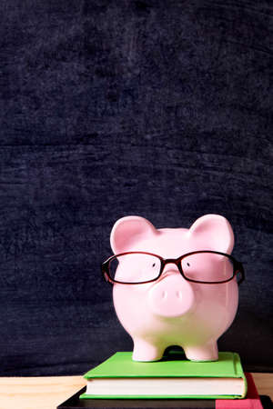 Piggy bank with glasses and blackboard