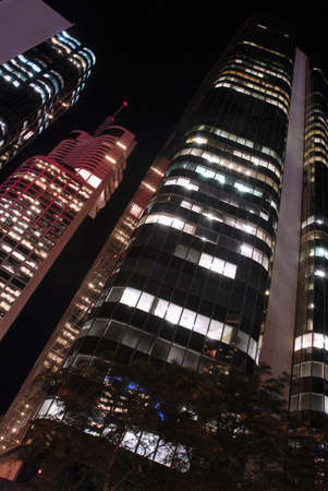 low angle views: Tall skyscraper buildings at night, low angle view