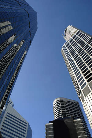 low angle views: Group of tall modern skyscraper buildings with deep blue sky, copy space Stock Photo