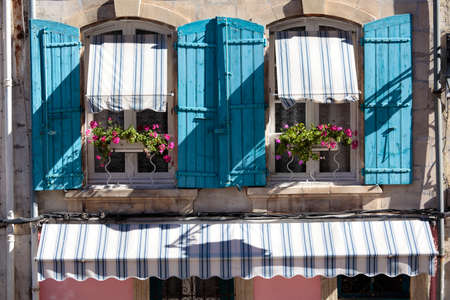 flower boxes: France provence style cottage windows, blue shutters and flower boxes. Stock Photo
