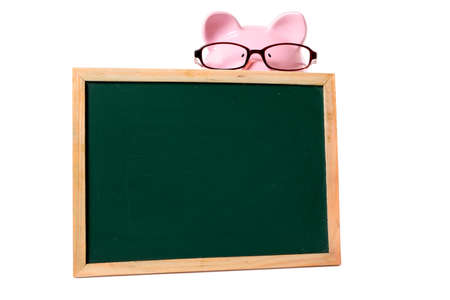 college fund savings: Piggy bank wearing glasses with small blank blackboard, isolated on white background