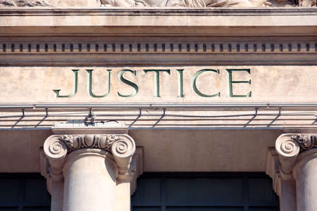 Justice sign on a Courthouse Building.