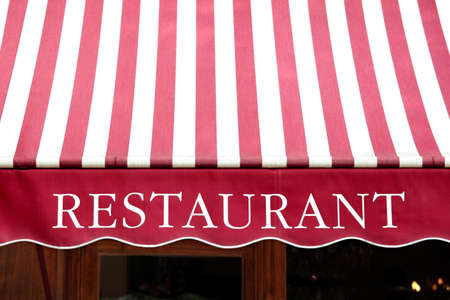 canopy: Striped french restaurant canopy in Paris france.