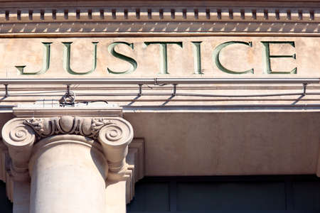 house outside: Justice sign on a Courtroom Building. Stock Photo