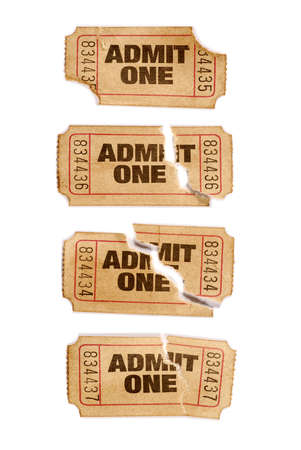 admit one: Several old torn and stained admit one movie tickets
