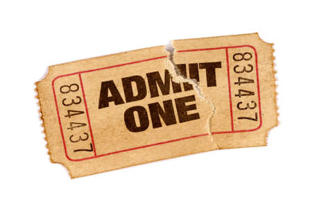 admit: Old torn and stained admit one movie ticket Stock Photo