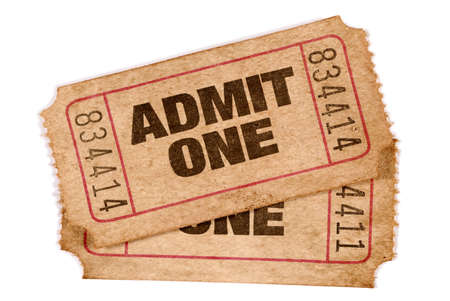 overlapped: Two old torn and stained admit one movie tickets
