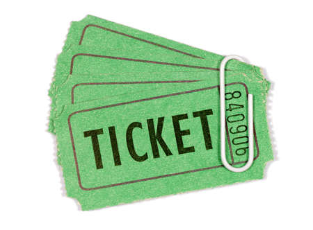 torn edges: Green admission or raffle tickets with white paperclip (please note that I have not isolated these objects in order to preserve the untidy torn edges). Stock Photo