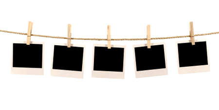 pegs: Several blank polaroid style instant photo print frames hanging on a rope or washing line, white background