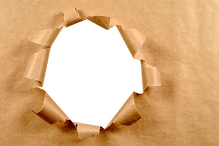 Brown craft paper background with untidy torn hole, white copy space