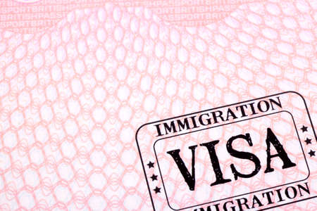 page up: Immigration visa stamp passport page close up
