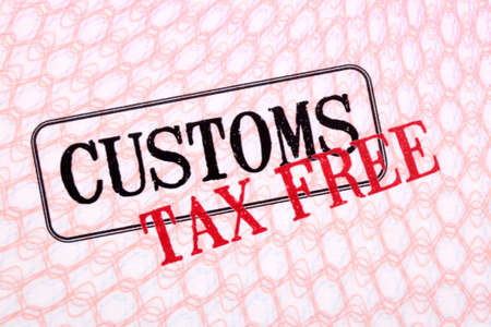 customs: Customs tax duty free stamps on passport page close up