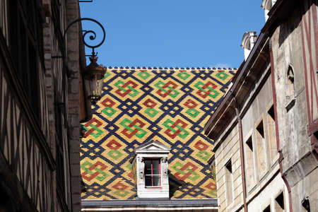 roof windows: Traditional ceramic roof tiles on a Government building in Dijon, Burgundy, France. Stock Photo