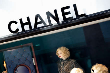 chanel: Chanel sign and shop front with part of window display situated on the Croisette Boulevard, Cannes, France.