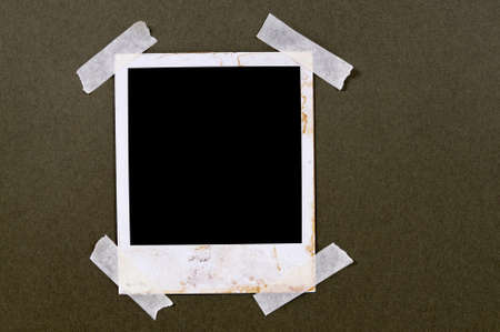taped: Old vintage stained style blank photo print frame taped to brown paper background