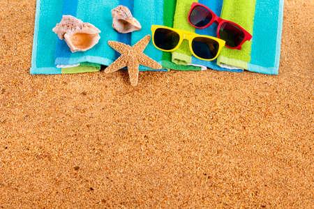 beach view: Tropical summer beach background, sunglasses, couple sunbathing, copy space