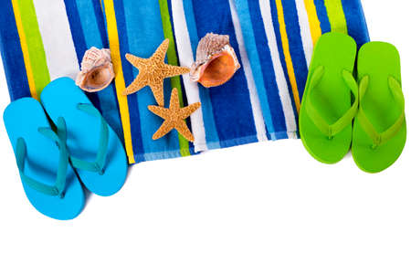beach view: Flip flops and summer beach objects isolated on white background