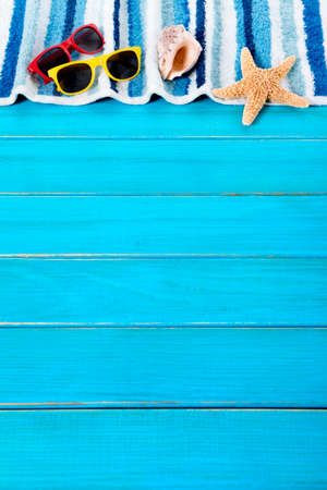 decking: Summer beach background border, sunglasses, towel, starfish, wood decking, copy space, vertical