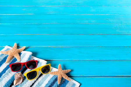 space wood: Summer beach background border, sunglasses, starfish, wood decking, copy space Stock Photo