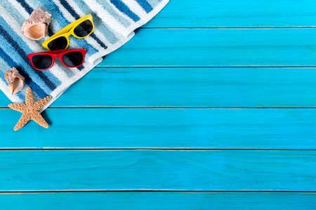 Summer beach background border, starfish, sunglasses, blue wood, copy space