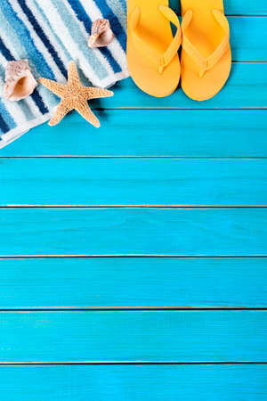 flipflops: Summer beach background border, starfish, flipflops, blue wood, copy space, vertical