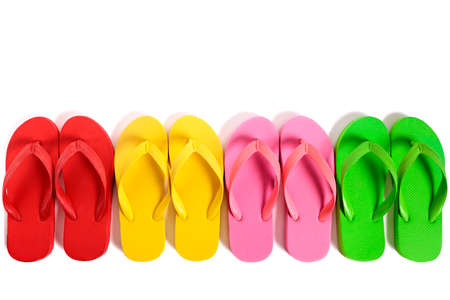 photo edges: Summer beach flip flops row isolated on white background.
