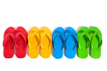 flops: Summer beach flip flops row isolated on white background.