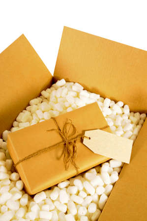 delivery box: Cardboard delivery box with brown paper mail package and polystyrene packing pieces.