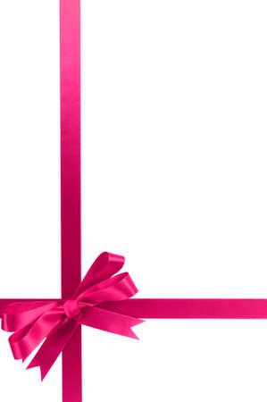 gift ribbon: Pink bow gift ribbon long vertical Stock Photo