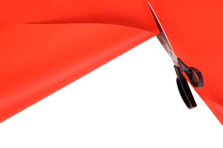red paper: Scissors cutting red paper background