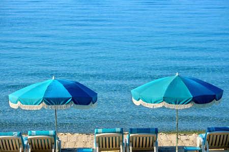 Beach resort umbrella and lounger