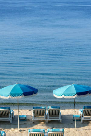 Beach umbrella and lounger