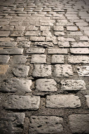 Close up of old cobble stone road surface background texture Imagens