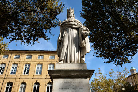 Aix-en-Provence, France - October 19, 2017 : the famous statue of King Roi Renee situated at the top of the main Cours Mirabeau market street