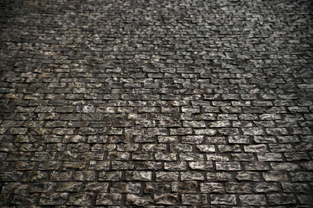 old grunge cobble stone road surface background texture