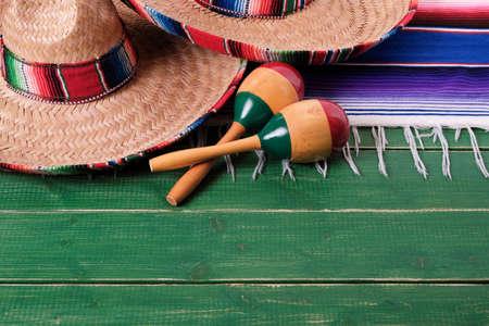 Mexico cinco de mayo festival wood background mexican sombreros maracas