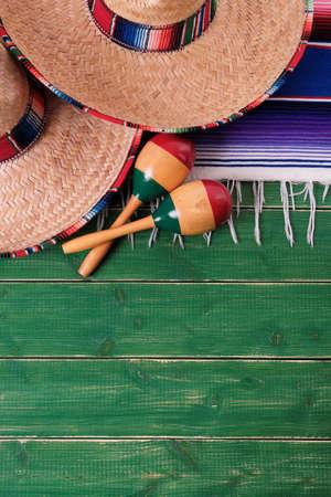 Mexico green wood background cinco de mayo mexican sombreros maracas vertical Stock Photo