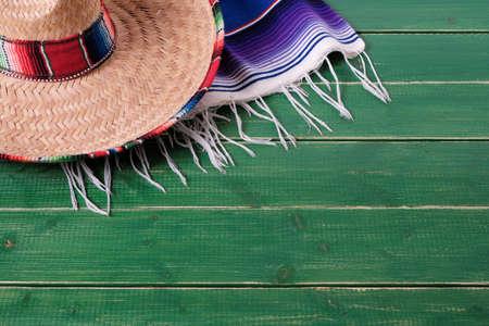 Mexico cinco de mayo wood background sombrero serape blanket