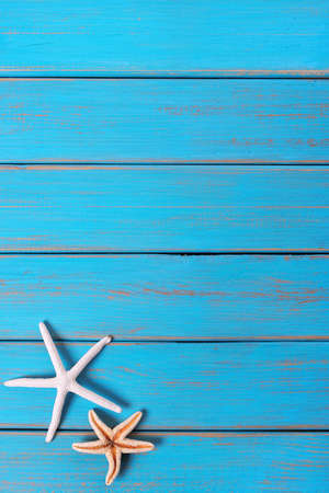 Starfish old weathered blue beach wood deck background vertical Stock Photo