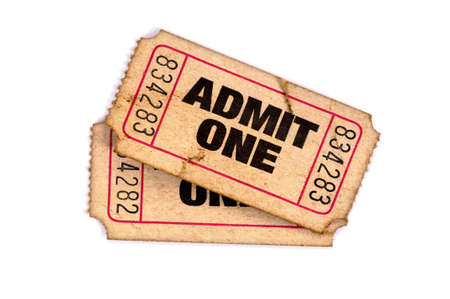 Old admit one torn used tickets isolated white background