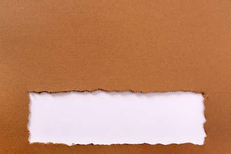 Torn brown paper background frame strip bottom edge Foto de archivo