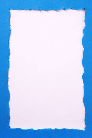 Torn blue paper ripped edge white background frame vertical