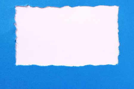 Torn blue paper white background border frame