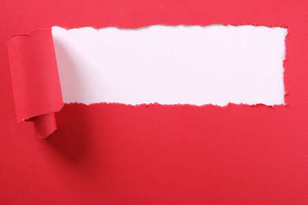 Torn red paper strip banner white background