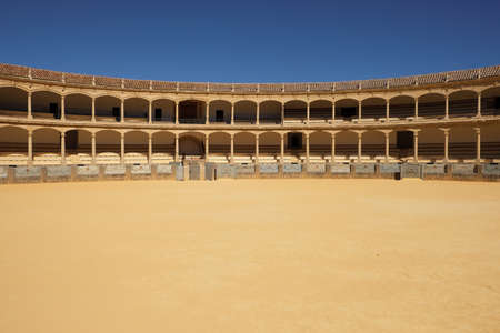 Ronda, Andalucia, Spain - March 16, 2019 : interior and seating gallery of the historic bullring in Ronda, Spain