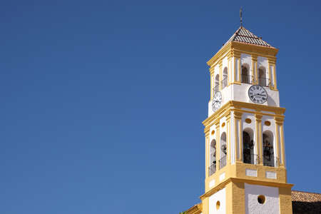 Marbella old town church bell tower isolated blue sky Editorial
