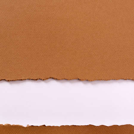 Torn brown paper background frame strip bottom edge Фото со стока