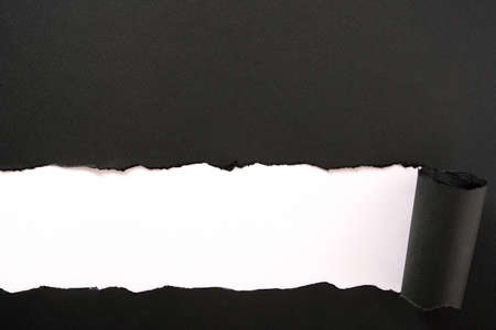 Torn black paper strip white background straight