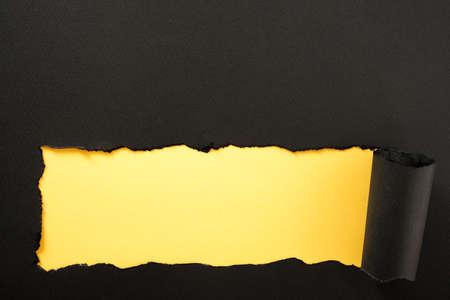 Paper strip torn black yellow background horizontal bottom edge